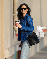 Krysten Ritter headed to 'Jimmy Kimmel' carrying a stylish black bucket bag.