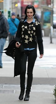 Krysten Ritter opted for a quirky, star-print crewneck sweater to pair over a button down while out in NYC.
