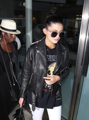 Kylie Jenner was spotted at LAX wearing a cool pair of floating-lens sunglasses.