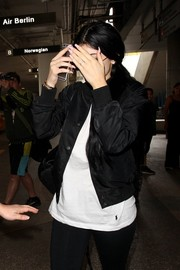 Kylie Jenner showed off her perfect pink mani while making her way through LAX.