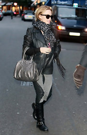 Kylie Minogue jazzed up her casual look with a sparkling metallic bag. A leopard print scarf and leather jacket complete the tough chic look.