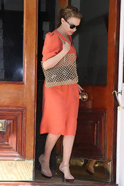 Peek a boo! Kylie carried a see through shopper bag in a neutral tan color. This is a fabulous warm weather accessory.