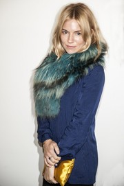 Sienna Miller glammed up her shirt with a Charlotte Simone fur scarf for the Paul Smith fashion show.