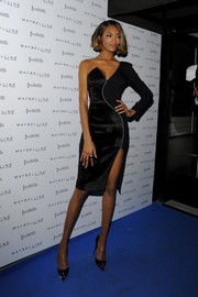 Black pumps with studded toe caps completed Jourdan Dunn's edgy-elegant ensemble.