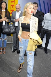 Pia Mia Perez was spotted at the Topshop Unique fashion show looking sexy in an unbuttoned print blouse layered over a black bandeau top.