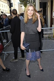Laura Carmichael styled her tee with a multitextured black and purple pencil skirt.