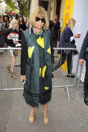 Anna Wintour went matchy-matchy at the Topshop Unique show with this floral coat and dress combo.