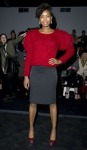 Tolula Adeyemi kept her look conservative and classic with a gray pencil skirt and red sweater at the Felder Felder Fashion show in London.