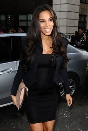 Rochelle Wiseman kept her look simple when she paired a black blazer over her little black dress at the Julien Macdonald runway show in London.