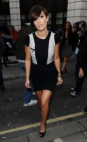 Frankie Sandford chose this black dress with sweater, capped sleeves and a checkered built-in vest for her daytime look during London Fashion Week.