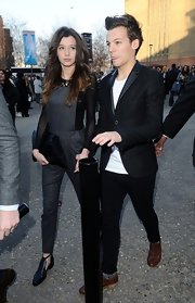 Eleanor Calder sported a pair of trendy oxford slip-ons as she attended London Fashion Week with her boyfriend.