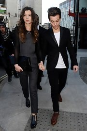 Eleanor Calder toted an oversized leather envelope clutch as she departed Topshop's show at London Fashion Week.