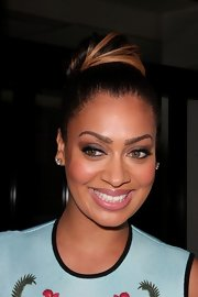 La La Anthony pulled her hair up in a voluminous high bun during a visit to the Fox Studios.