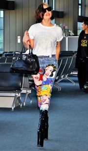 For her arm candy, Lady Gaga chose a buckled leather tote by Versace.