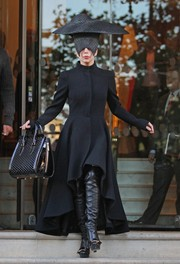 For her arm candy, Lady Gaga chose a honeycomb-patterned patent tote by Alexander McQueen.