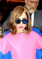 Lady Gaga complemented a voluminous pink-and-blue dress with some strange-looking goggle glasses.