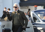 Karl paired his knit sweater with a matching blazer.