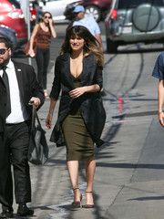 Lake Bell layered a black duster coat over a low-cut olive dress for her visit to 'Kimmel.'