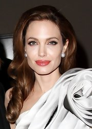 Angelina Jolie attended the Paris premiere of 'In the Land of Blood and Honey' wearing her hair in soft sleek curls.