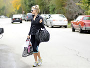 Ali Larter dressed up her workout closses with a luxe black quilted Chanel tote.