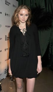 Lily Cole looked funky at the screening of 'Lily Cole's Amazon Adventure' in a bubble-hem LBD with a ruffle neckline.