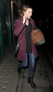 Laura Carmichael carried a leather swingpack as she left work.