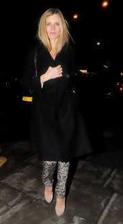 Laura Bailey complemented her cold weather attire with nude suede pumps.
