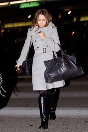 Lauren is bundled at the airport in a dove gray wool coat and cozy scarf.