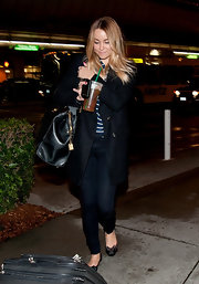 Lauren Conrad looked effortlessly pulled together at the airport in a nautical striped shirt, black wool coat and dark skinny jeans.