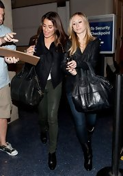 Lea was spotted at the airport in a pair of Dark Ivy highrise leatherette skinny jeans.