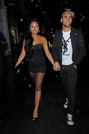 Leigh-Anne Pinnock opted for a strapless little black dress with mesh overlay while out in London.
