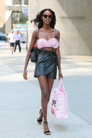 Leila Nda sealed off her ensemble with a personalized pink shopper bag by Victoria's Secret.