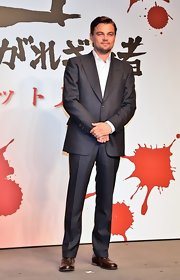 Leonardo DiCaprio looked smart and elegant in a charcoal suit at the 'Django Unchained' press conference.