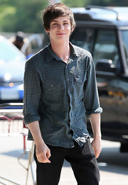 Logan Lerman was dressed for comfort in a plaid button-down shirt as he departed Vancouver International Airport for a film shoot.