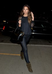 Lily Aldridge styled her travel outfit with a pair of slouchy brown suede boots by Isabel Marant.