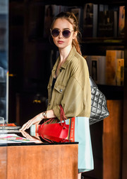 Lily Collins stepped out in Beverly Hills wearing a pair of chic shades with transparent cateye frames.
