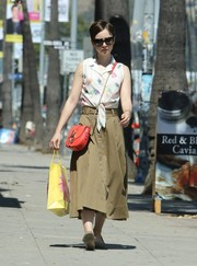 Lily Collins went shopping wearing a cute tie-waist eyelet print blouse.