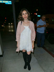 Lily Collins added some warmth with a short pink duster.