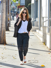 For her footwear, Lily Collins chose a pair of white cross-strap slides.