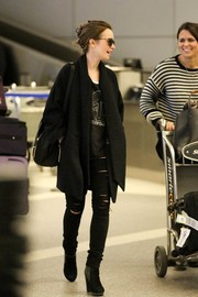 Lily Collins was spotted at LAX rocking a pair of slashed black jeans.