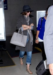 Lily Collins arrived at LAX looking stylish in a gray suede coat.