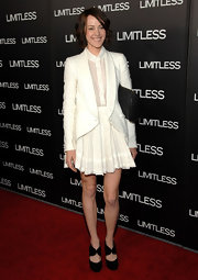 Jena dons a sophisticated ensemble for the premiere of 'Limitless' with her white blazer and full skirt.
