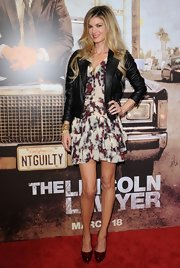 Marisa wears a sweet floral print dress under her black leather jacket for the premiere of 'the Lincoln Lawyer.'