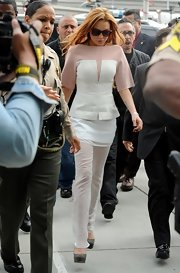 Lindsay Lohan kept her look at her hearing very professional and sleek with these sheer white pants.