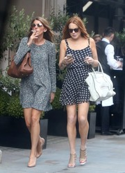 Lindsay Lohan teamed her sundress with edgy-chic nude cutout booties.