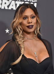 Laverne Cox finished off her look with a vampy purple lip.