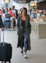 Lisa Rinna completed her comfy airport look with a pair of gray slip-ons.