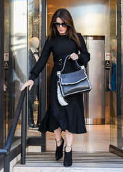 Lisa Vanderpump chose a pair of black booties with bedazzled straps to finish off her look.