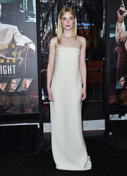 Elle Fanning went for minimalist elegance in a strapless white column dress by Oscar de la Renta at the LA premiere of 'Live by Night.'