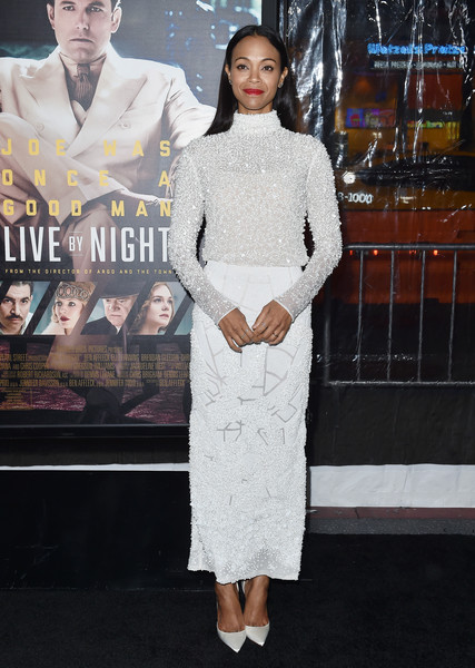 Zoe Saldana completed her all-white ensemble with a pair of satin pumps by Christian Louboutin.